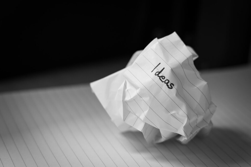 A rumpled sheet of paper with business Ideas